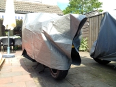 ... this groundsheet now also functions as a tarp and motorcyclecover.