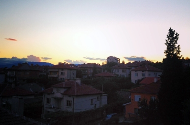 Beautiful view of the sun setting in Rose Valley and the town Karlovo in Bulgaria